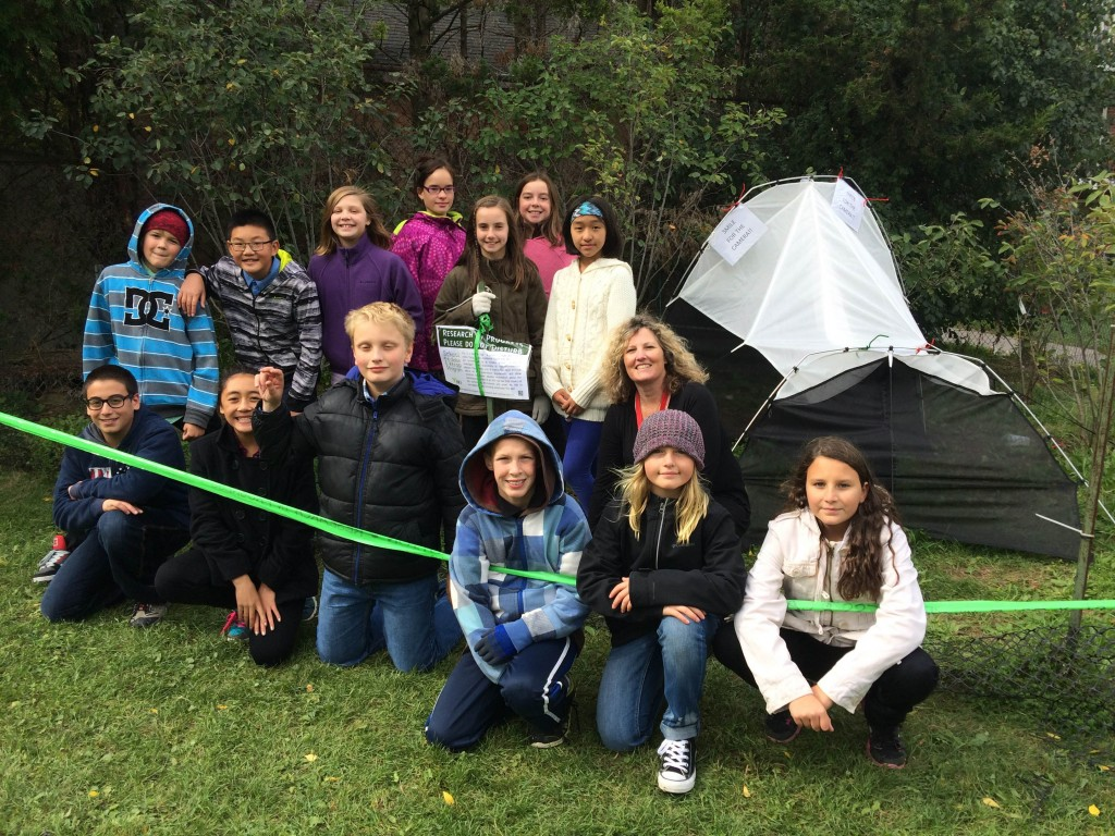 Group shot of Mrs. Cochrane's Grade 6 class with their Malaise Trap!